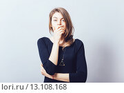 Купить «young adult woman holding hand over her mouth over grey background», фото № 13108168, снято 23 апреля 2015 г. (c) Ingram Publishing / Фотобанк Лори