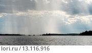Купить «View of distant rain falling at Lake of the Woods, Ontario, Canada», фото № 13116916, снято 1 сентября 2014 г. (c) Ingram Publishing / Фотобанк Лори