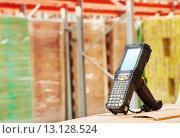 Купить «barcode scanner at warehouse», фото № 13128524, снято 15 октября 2015 г. (c) Дмитрий Калиновский / Фотобанк Лори