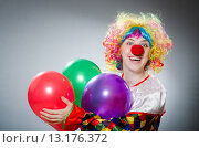 Купить «Funny clown in comical concept», фото № 13176372, снято 1 июля 2015 г. (c) Elnur / Фотобанк Лори