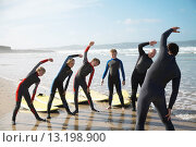 Купить «Back view of a surfing instructor and a group of students stretching on a beach», фото № 13198900, снято 24 октября 2008 г. (c) age Fotostock / Фотобанк Лори