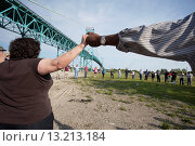 Detroit, Michigan - Community activists in southwest Detroit celebrate after tearing down a fence blocking access to part of Riverside Park  The fence... Стоковое фото, фотограф Jim West / age Fotostock / Фотобанк Лори
