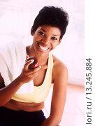 Купить «Apple after her exercise», фото № 13245884, снято 18 января 2019 г. (c) age Fotostock / Фотобанк Лори