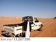 Купить «A beduin man with his 4x4 car, Wadi Rum desert, Jordan, Middle East.», фото № 13267596, снято 16 декабря 2009 г. (c) age Fotostock / Фотобанк Лори