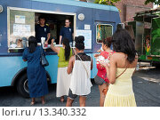 Купить «Hungry attendees to the AfroPunk Festival in Commodore Barry Park in Brooklyn in New York enjoy iced drinks from the Kelvin Slush truck at the food truck...», фото № 13340332, снято 5 июля 2020 г. (c) age Fotostock / Фотобанк Лори