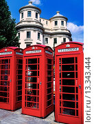 Купить «Colorful red telephone boxes in The Strand in sunny London, England, against a background of J  Nash architecture and blue skies,», фото № 13343444, снято 7 декабря 2019 г. (c) age Fotostock / Фотобанк Лори