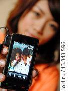 Купить «Teenage girl listening to music», фото № 13343596, снято 19 декабря 2007 г. (c) age Fotostock / Фотобанк Лори