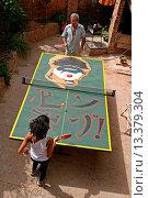 Купить «people playing ping-pong, Fals, Bages, Catalonia, Spain», фото № 13379304, снято 24 апреля 2019 г. (c) age Fotostock / Фотобанк Лори