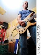 Купить «young music player and band friends have training in home garage», фото № 13394736, снято 30 марта 2020 г. (c) age Fotostock / Фотобанк Лори