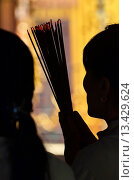Купить «Vietnam, near Ho Chi Minh City, Binh Dung, people praying in Pagoda on the first day of the second lunar month», фото № 13429624, снято 12 июля 2020 г. (c) age Fotostock / Фотобанк Лори