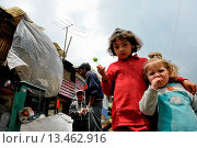 Купить «Little Colombian girls pose for a picture in the 'Invasión', a temporary slum in Bogota, Colombia, 1 April 2006  The internal armed conflict in Colombia...», фото № 13462916, снято 20 марта 2019 г. (c) age Fotostock / Фотобанк Лори