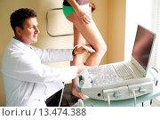 Купить «Patient undergoing a Doppler ultrasound angiodynography scan of the legs to study blood flow and explore potential deep vein thrombosis.», фото № 13474388, снято 21 февраля 2018 г. (c) age Fotostock / Фотобанк Лори
