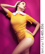 Купить «High fashion photo of a young woman wearing bright yellow vintage style clothes on pink background», фото № 13485856, снято 20 июня 2019 г. (c) age Fotostock / Фотобанк Лори