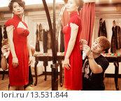 Купить «Fashion designer, Lu Kun fitting a traditional qipao inspired modern dress on a model», фото № 13531844, снято 13 ноября 2018 г. (c) age Fotostock / Фотобанк Лори