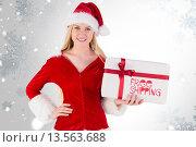 Купить «Composite image of festive blonde holding a gift», фото № 13563688, снято 10 июля 2020 г. (c) Wavebreak Media / Фотобанк Лори