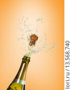 Composite image of champagne popping. Стоковое фото, агентство Wavebreak Media / Фотобанк Лори