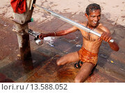Купить «Man using a water pump for bathing, Mathura, Uttar Pradesh, India, Asia», фото № 13588052, снято 15 октября 2018 г. (c) age Fotostock / Фотобанк Лори