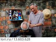 Купить «Man having his hair cut in an open air barbers shop in Hanoi, Vietnam,South East Asia,Asia», фото № 13603628, снято 23 июня 2008 г. (c) age Fotostock / Фотобанк Лори