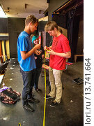 Купить «Drama students use a tape measure to plan stage space for sets in a school play in San Clemente, CA. Note girl's aquamarine dyed hair.», фото № 13741664, снято 24 сентября 2018 г. (c) age Fotostock / Фотобанк Лори