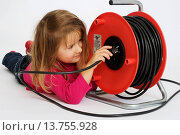 Купить «little girl lying on the belly playing with a cable drum», фото № 13755928, снято 27 июня 2019 г. (c) age Fotostock / Фотобанк Лори