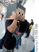Купить «young visitor of the Gamescom (the world's largest trade fair for video games) wearing a mask with a pixel face, Germany, North Rhine-Westphalia, Cologne», фото № 13759100, снято 18 января 2019 г. (c) age Fotostock / Фотобанк Лори