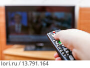 Купить «Hand switches TV channels with news», фото № 13791164, снято 20 февраля 2019 г. (c) PantherMedia / Фотобанк Лори