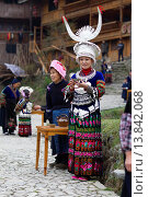 Купить «China ,Guizhou province , Langde village , Long Skirt Miao people in traditional dress.», фото № 13842068, снято 16 июля 2018 г. (c) age Fotostock / Фотобанк Лори