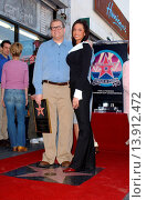 Купить «Drew Carey & Danielle at the ceremony honoring Drew Carey with the 2,216th star on the Hollywood Walk of Fame. Hollywood California. February 21st, 2003. Photo by Patrick Rideaux/PicturePerfect.», фото № 13912472, снято 19 июля 2013 г. (c) age Fotostock / Фотобанк Лори
