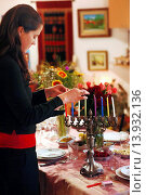 Купить «A woman prays before lighting candles for the Jewish holiday of Hanukkah.», фото № 13932136, снято 30 ноября 2007 г. (c) age Fotostock / Фотобанк Лори