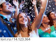 Купить «smiling friends at concert in club», фото № 14123364, снято 20 октября 2014 г. (c) Syda Productions / Фотобанк Лори