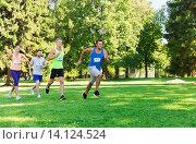 Купить «happ young sportsmen racing wit badge numbers», фото № 14124524, снято 16 августа 2015 г. (c) Syda Productions / Фотобанк Лори