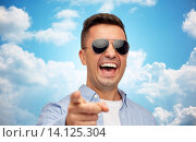 Купить «laughing man in sunglasses pointing finger on you», фото № 14125304, снято 22 июля 2015 г. (c) Syda Productions / Фотобанк Лори