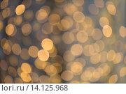 Купить «blurred golden lights bokeh», фото № 14125968, снято 1 октября 2015 г. (c) Syda Productions / Фотобанк Лори