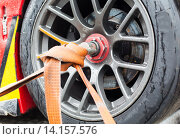 Купить «close up of race car wheel with tow rope tied to», фото № 14157576, снято 15 октября 2015 г. (c) Syda Productions / Фотобанк Лори