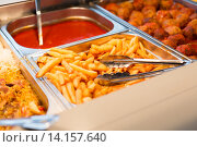 Купить «close up french fries of and other dishes on tray», фото № 14157640, снято 15 октября 2015 г. (c) Syda Productions / Фотобанк Лори
