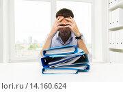 Купить «sad businessman with stack of folders at office», фото № 14160624, снято 18 июня 2015 г. (c) Syda Productions / Фотобанк Лори