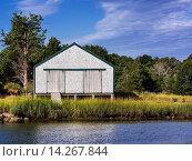 Купить «Rustic boathouse, Eastham, Cape Cod, Massachusetts, USA.», фото № 14267844, снято 9 октября 2013 г. (c) age Fotostock / Фотобанк Лори