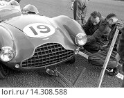 Купить «Mechanics working on an Aston Martin DB3S at the Dundrod TT, Northern Ireland 1953.», фото № 14308588, снято 7 ноября 2013 г. (c) age Fotostock / Фотобанк Лори