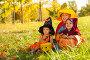 Дети в костюмах для праздника Хеллоуин сидят на траве, фото № 14338744, снято 26 сентября 2015 г. (c) Сергей Новиков / Фотобанк Лори