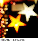 Купить «Christmas decorations - colored stars with beautiful bokeh shot with tilt-shift lens.», фото № 14342988, снято 11 декабря 2018 г. (c) age Fotostock / Фотобанк Лори