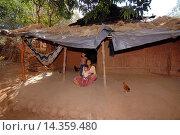 Купить «Woman with her children sitting outside hut, Bhil Tribe, Madhya Pradesh, India.», фото № 14359480, снято 25 февраля 2008 г. (c) age Fotostock / Фотобанк Лори