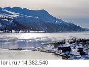 Купить «View across Tromso Sound to Tromso and the Lyngen Alps from Kvaloya Island in Arctic Circle Northern Norway», фото № 14382540, снято 21 октября 2018 г. (c) age Fotostock / Фотобанк Лори
