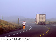 Купить «Runner on highway in fog with truck on road, near Manila, Samoa Peninsula, Humboldt County, CALIFORNIA.», фото № 14414176, снято 27 января 2014 г. (c) age Fotostock / Фотобанк Лори