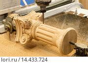 Купить «The machine for manufacturing of a wooden column.», фото № 14433724, снято 23 октября 2012 г. (c) age Fotostock / Фотобанк Лори