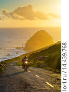 Купить «Motorcycle at sunset on the Mattole Road, at Cape Mendocino, on the Lost Coast, California.», фото № 14439768, снято 19 сентября 2019 г. (c) age Fotostock / Фотобанк Лори