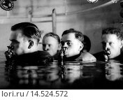 Купить «German submariners' exercise. In a submariners' school of the German army, the students equipped with respirator and life jacket practise in the immersion chamber. Germany, September 1944», фото № 14524572, снято 27 мая 2018 г. (c) age Fotostock / Фотобанк Лори