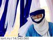 Купить «UMM AL-MAA, LIBYA - MAY 28: portrait of a tuareg tribesman, oasis um el ma, libyan desert, libya on May 28, 2008 in Umm Al-maa, Libya.», фото № 14543060, снято 28 мая 2008 г. (c) age Fotostock / Фотобанк Лори