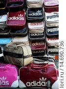 Купить «Fake Adidas and Puma sports bags at a market in Bangkok», фото № 14690736, снято 12 декабря 2009 г. (c) age Fotostock / Фотобанк Лори