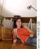 Купить «Young Woman / twen, with headphones and drumsticks lying on the floor relaxing», фото № 14699120, снято 26 марта 2005 г. (c) age Fotostock / Фотобанк Лори
