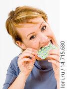Купить «woman biting a package of pills in her hand», фото № 14715680, снято 27 мая 2006 г. (c) age Fotostock / Фотобанк Лори